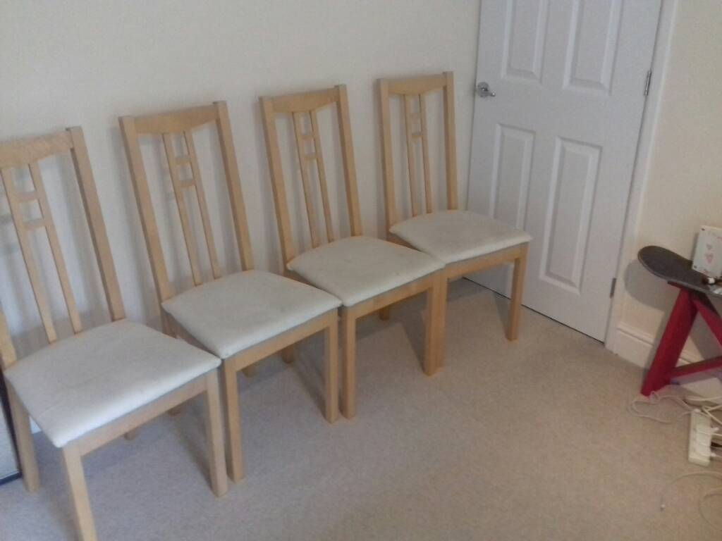 4 dining chairsin Cirencester, GloucestershireGumtree - 4 dining table chairs, oak coloured originally from ikea. Cream fabric seat covers are marked but it is possible to wash these and/or change them
