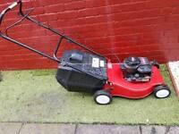 Champion push petrol lawnmower with grass box