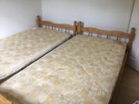 Pine bunk beds which can be converted into 2 full size single beds. Sprung mattresses included.