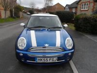 2005 Blue Mini Cooper in lovely condition.