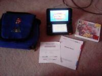This 3ds is in great condition comes with charger super smash bros game and a neat little bag