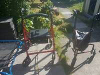 2 red strollers (3 and 4 wheels)