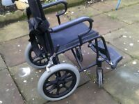 PUSH ALONG FOLDING WHEELCHAIR IN GOOD CONDITION IS LIGHTWEIGHT