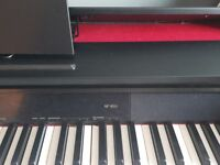Celviano Piano AP-450- Digital. Beautiful piano, bought a year ago for £900. Opens up like grand.