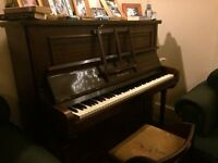 Free piano. Very slightly out of tune, but otherwise fully working.