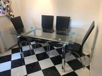 Glass Kitchen Dining Table with 6 leather chairs