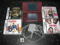 Nintendo DSI XL with original charger and 5 boxed games with full instructions £80