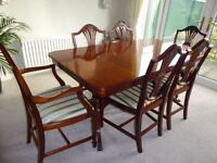Solid Mahogany extending table and 6 chairs by Beresford and Hicks of England