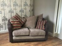 2 Seater small Brown faux leather sofa with 3 large cushions and 2 small cushions