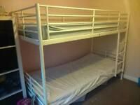White metal bunkbeds