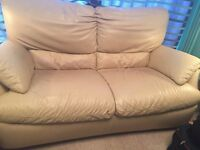 Cream leather Natuzzi settee