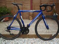 Vittesse Sprint Mens road racing bike. Blue, 21 speed revoshift shimano gears, medium frame