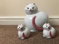 Ornamental cats.