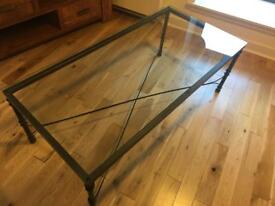 Glass table with metal legs