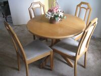 Klose Collection dining table and four chairs.