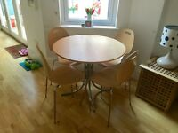 Lovely Great condition wood effect round dining room table and 4 chairs
