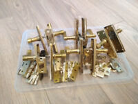 Set of bronze door handles, latches, hinges