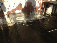 Glass coffee table with chrome base for sale