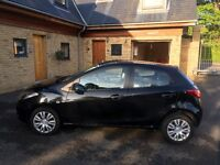 Black Mazda2, 75,000 miles, 3 lady owners. Full service history and MOT until 30/3/2018