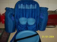 picnic back pack with plates cups knifes and forks 2 pockets for water on side