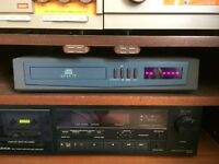 Quad stereo system including speakers, CD player, amp and tuner.