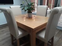 4 X Cream leather dining chairs with solid oak legs