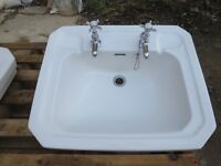 Large Victorian-style basin with matching taps