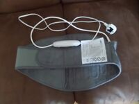 Barely used iGuerburn lumbar heating pad. 3 settings, plug in, 100watts.