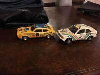 2 vintage cars