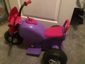 Pink/purple electric ride on