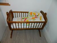 Mothercare swinging crib/cot,with 2 mattresses and bumper set.