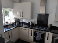Cream Cooke & Lewis Kitchen with Black Granite Worktop