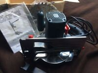 old circular saw with box and accessories