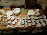 Huge Collection of plates and side plates and bowls and serving dishes