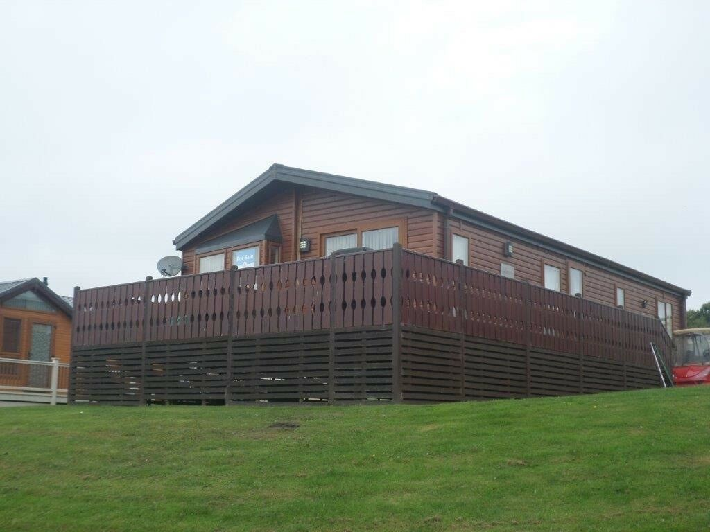 Luxury Lodge 2012 Willerby Boston with wood cladding for sale on Percy Wood 5* holiday park