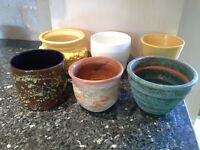6 assorted decorative indoor plant pots.