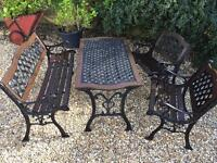 Antique heavy cast iron table and chairs