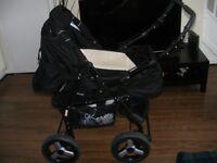 Black/white pram with car seat