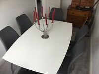 Contemporary White table and 6 Grey Faux Leather chairs.NEW used once
