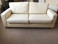 Cream two-seater sofa