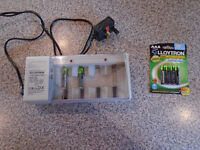 "BATTERY CHARGER, used and 4 PACK AAA ""LLOYTRON"" RECHARGEABLE BATTERIES for LANDLINE PHONE, BRAND NEW"