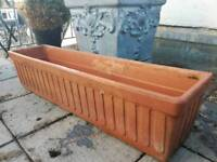 Planter, solid terracotta. 32 inches long