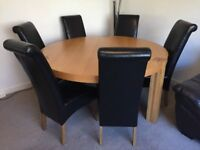 Round 150cm diameter oak dining table with 6 black faux leather high back chairs