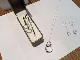 Brand new Silver bracelet, earrings, chain and pendant