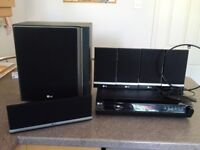 LG DVD Receiver System (6 speakers) Model HT502SH-D0. Fully working and looks new