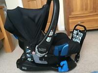 Britax baby carrier with belted car seat base and rain cover