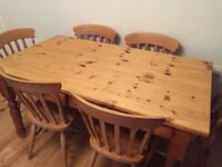Stunning Solid pine farmhouse dining table with 6 traditional chairs!