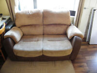 Two seater leather and material sofas