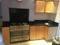 Kitchen units and granite work tops