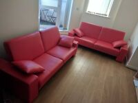 2 x Red Faux Leather Sofa beds